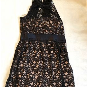 High neck, black lace dress with nude underlay